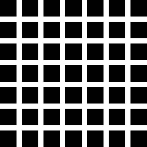 A Hermann Grid. White lines with black squares. An example of a physiological optical illusions.