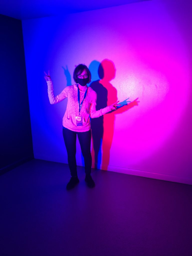 One of our staff members, Melissa, standing in one of our exhibits at the Museum of Illusions New York.