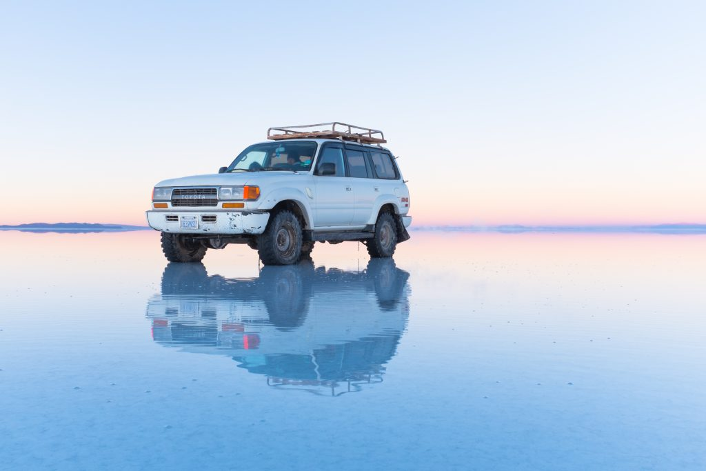 A car reflecting on the surface of the Bolivian Salt Flats. Used for the MOI NYC blog on natural illusions.