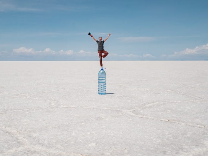 A visitor getting creative with perspective at the Bolivian Salt Flats. Used for the MOI NYC blog.